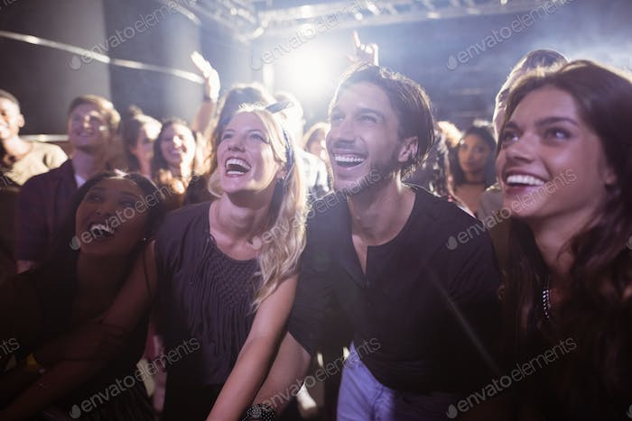 Cheerful people enjoying at nightclub