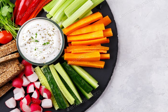 Healthy vegetables snack with yoghurt