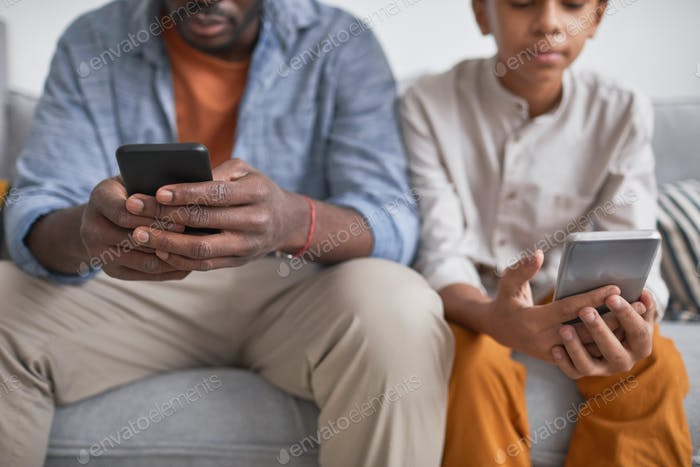 Man and Boy Using Smartphones