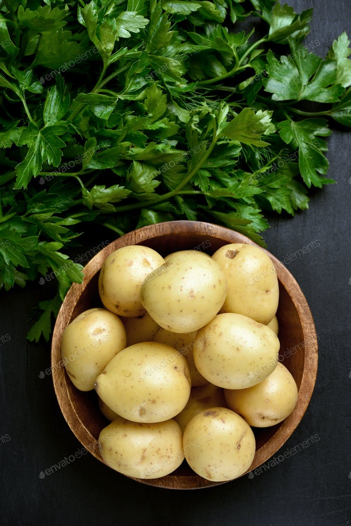 Raw potatoes and parsley, top view