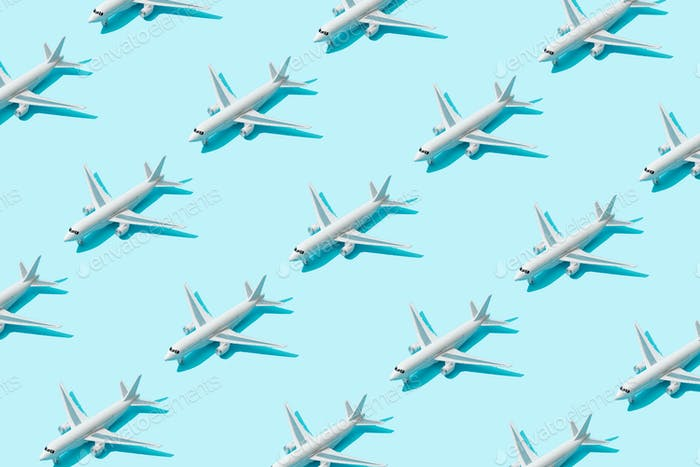 Trendy sunlight Summer pattern made with airplane camera on bright light blue background.