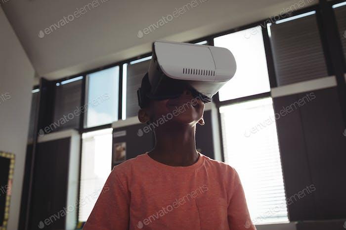 Low angle view of boy wearing virtual reality simulator