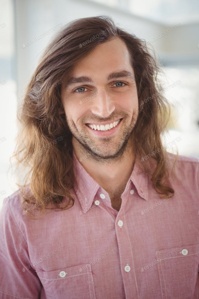 Portrait of cheerful hipster in office