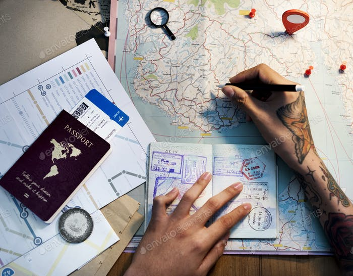Aerial of hands planning about travel trip and journey
