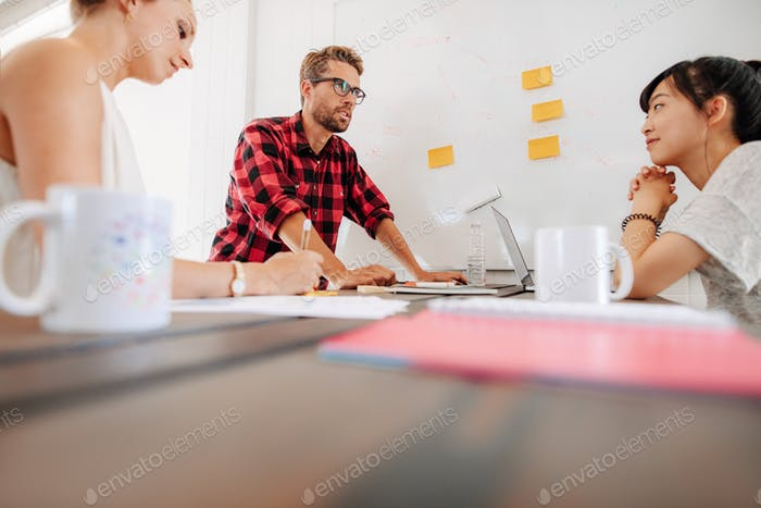 Discussion during business meeting in conference room