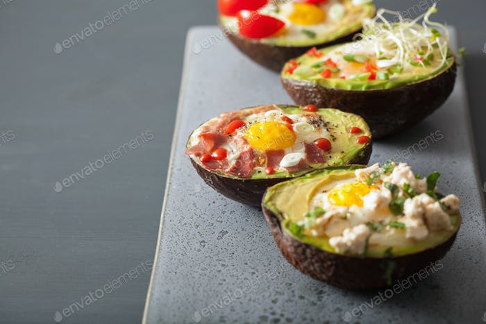 eggs baked in avocado with bacon, cheese, tomato and alfalfa spr
