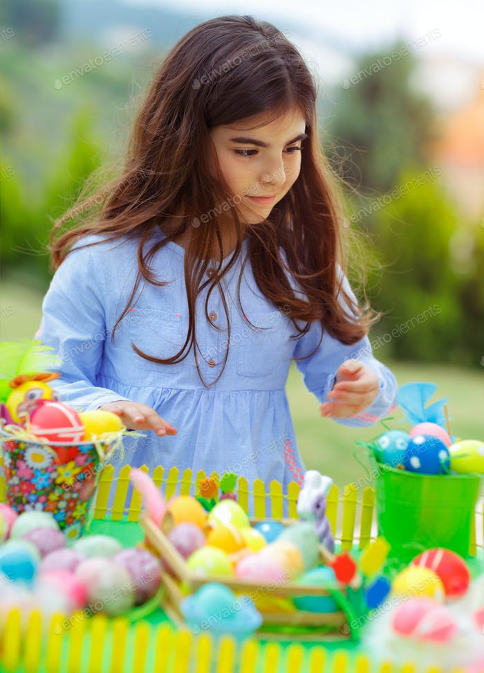 Nice girl playing with Easter eggs