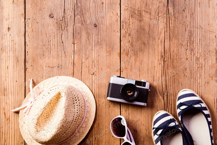 Summer vacation composition. Hat, camera, sunglasses and espandr