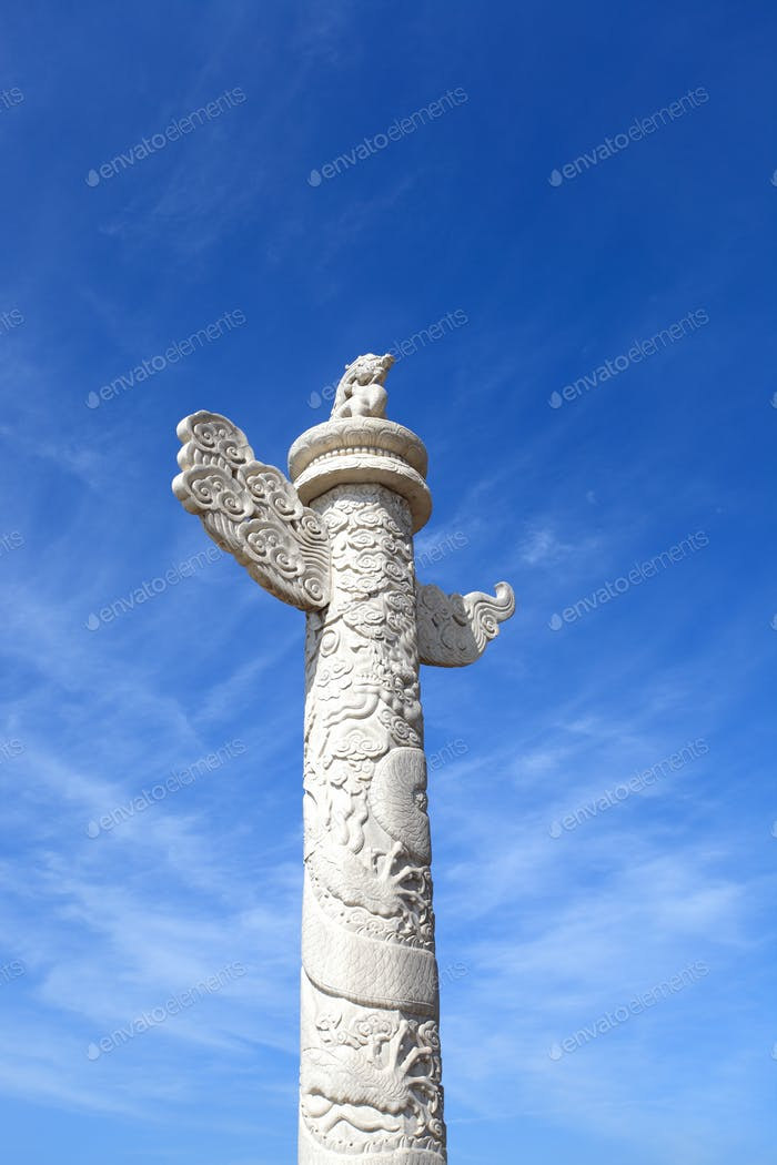 ornamental columns against a blue sky