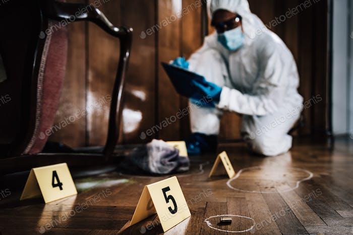 Crime Scene Detective Examining Evidence