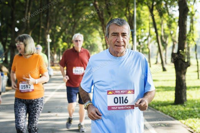 Senior athletes running at the park