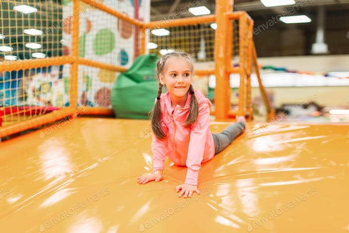 Cute girl having fun on inflatable attraction