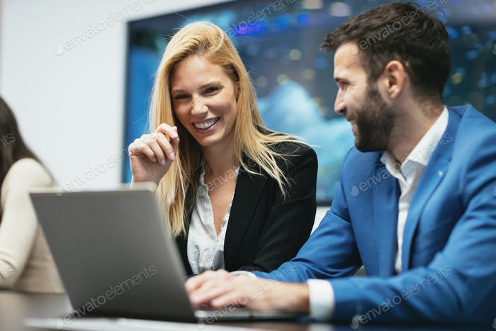 Business colleagues working in office