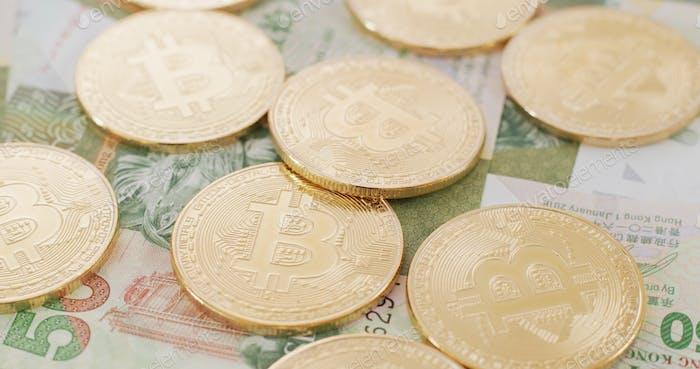 Billete Bitcoin y Hong Kong