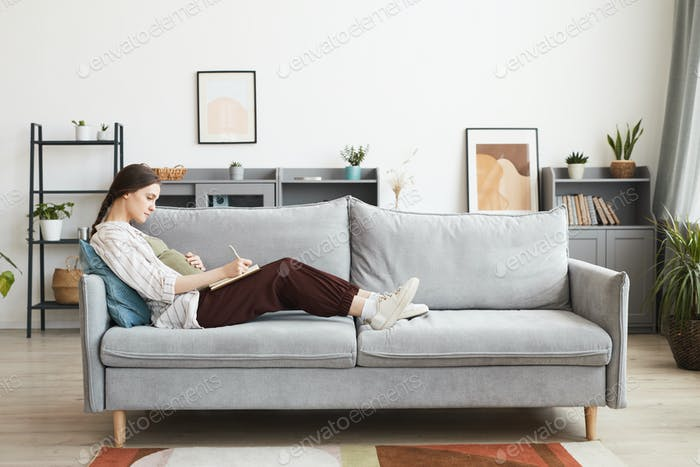 A person resting on a couch