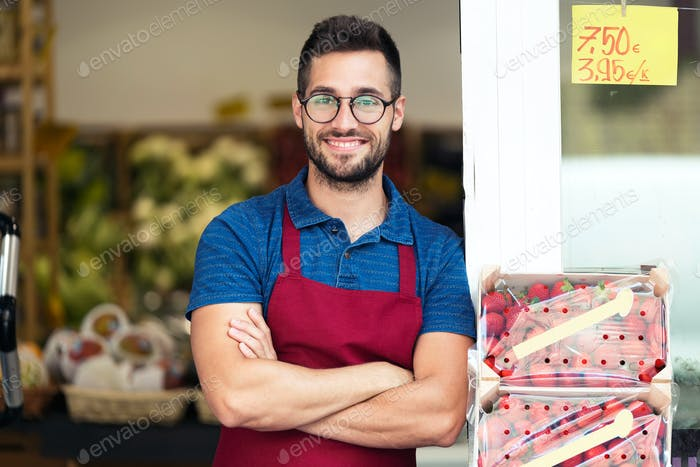 Portrait of handsome young salesman looking at camera in health