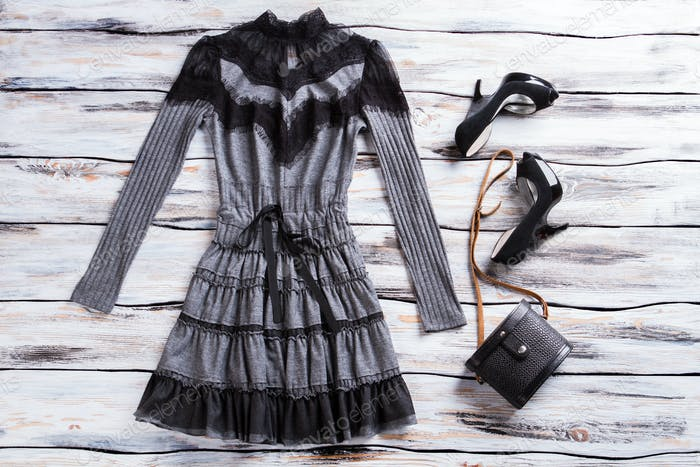 Gray dress with long sleeves.