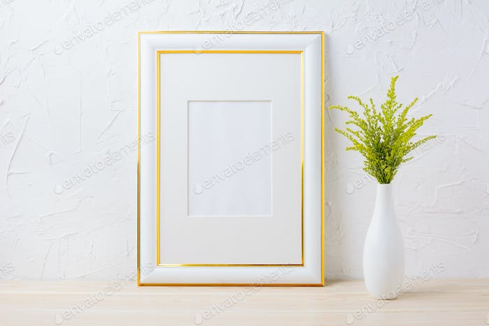 Gold decorated frame mockup with ornamental grass in exquisite v