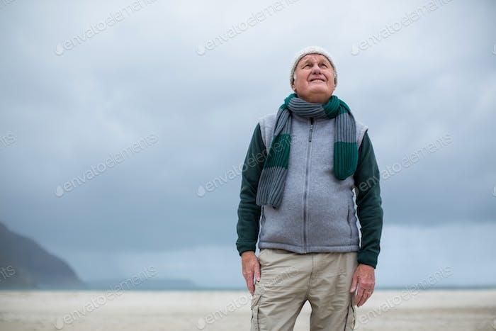Senior man standing on the beach