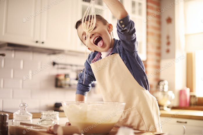 Boy tries to homemade batter muffin
