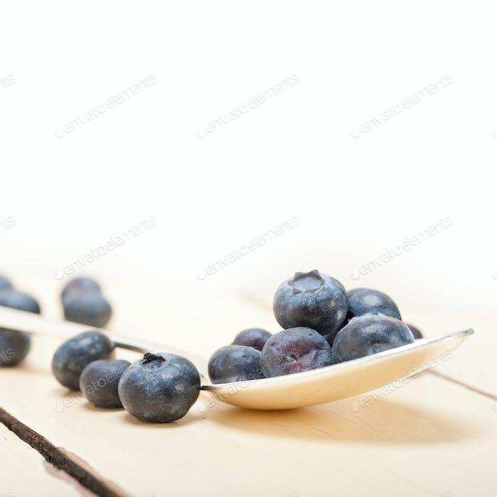fresh blueberry on silver spoon