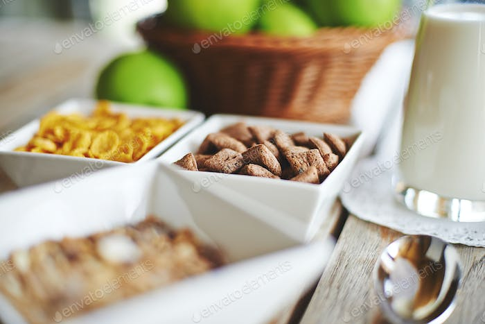 Muesli, fresh milk and apples with beautiful bokeh