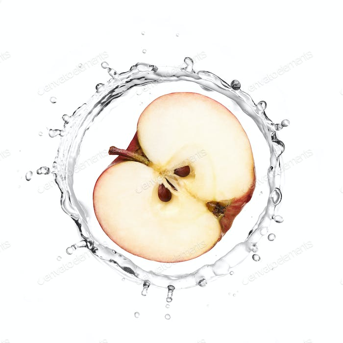 Red apple in water splash