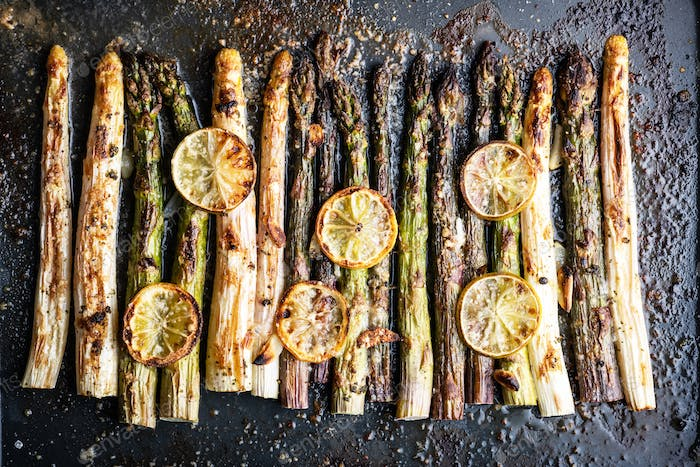 Baked white, purple and green asparagus sprouts