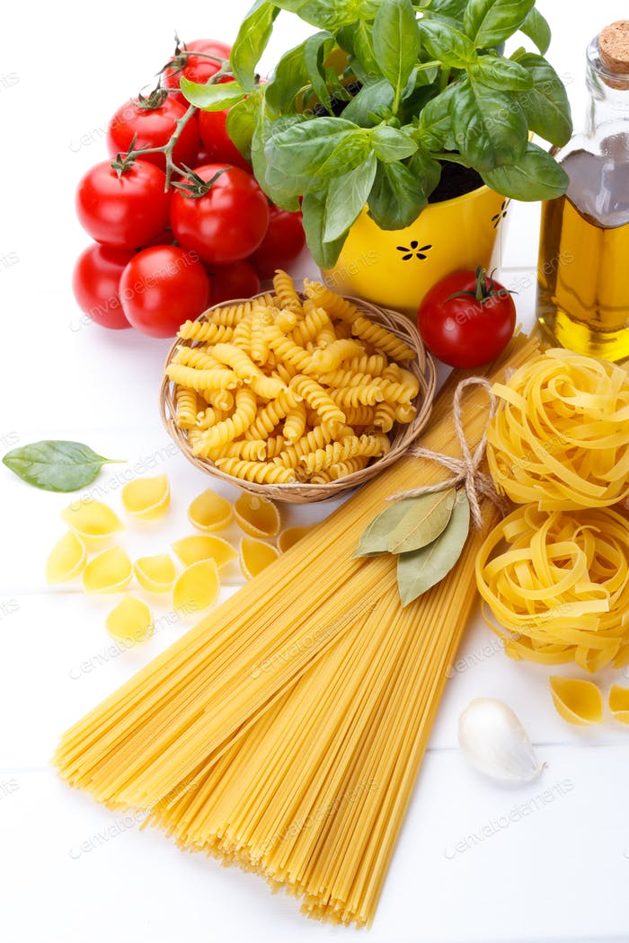 Italian food pasta ingredients,basil,tomato,olive oil on white w