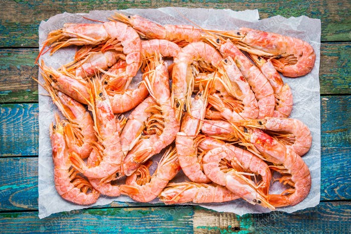 fresh raw prawns on paper