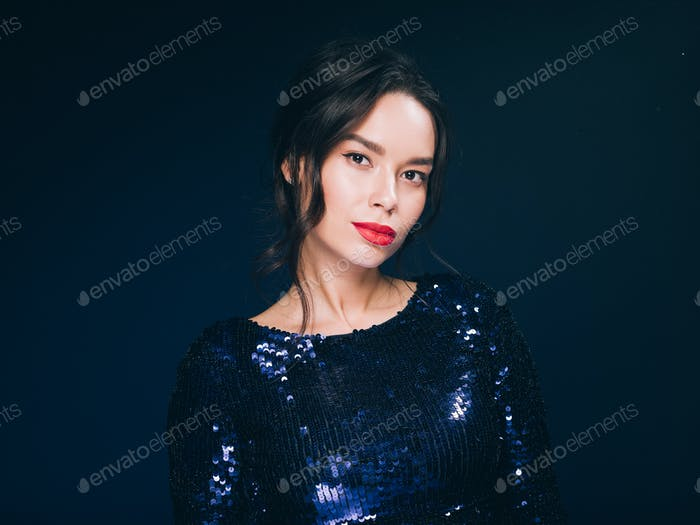 Woman in sequin dress night club concept red lips asian beauty