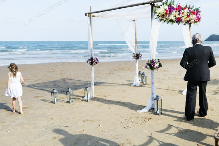 Guests at a beach wedding