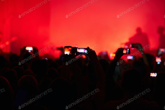 Taking photo at concert