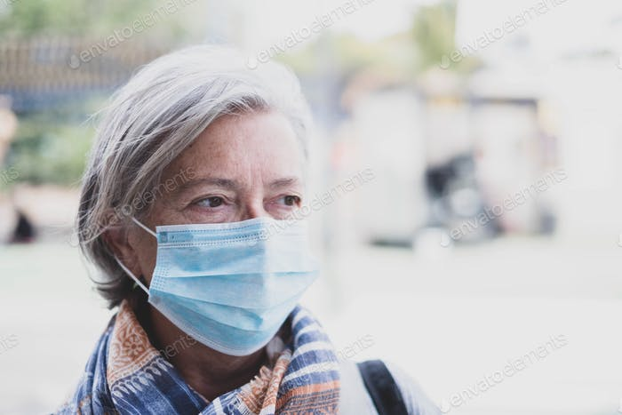 close up of face of mature woman wearing medical mask prevention coronavirus or covid-19