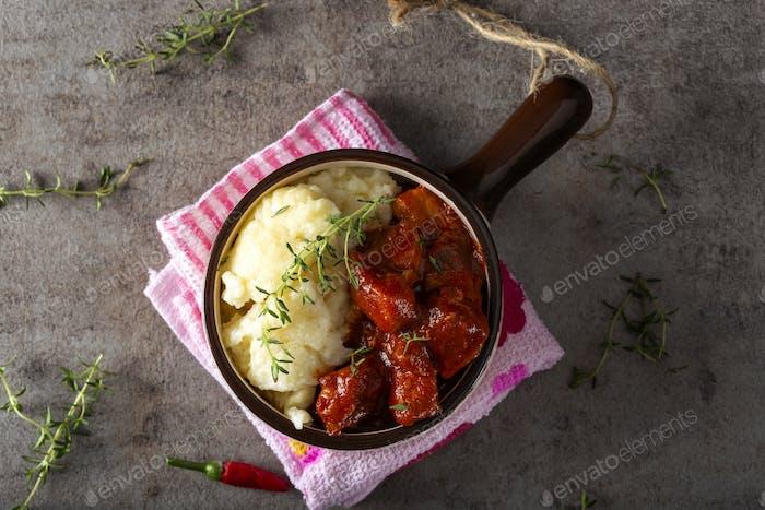 Pork goulash meat with dumplings