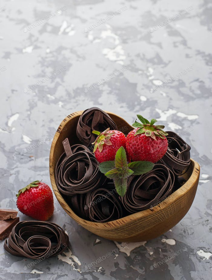 Uncooked chocolate pasta and strawberry