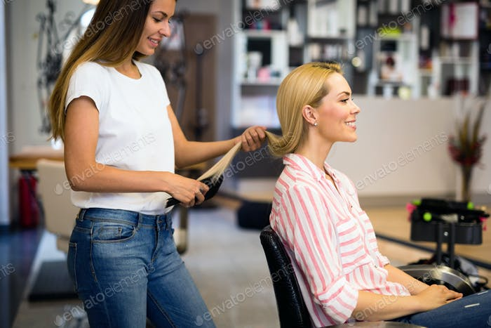 Happy woman at the hair salon