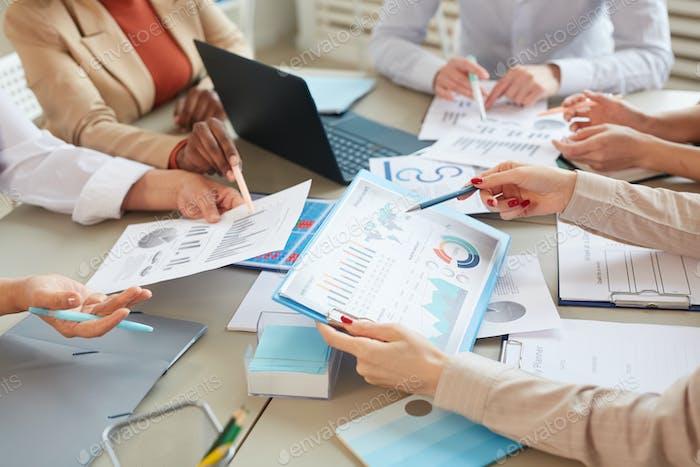 Close up of Data Charts at Business Meeting