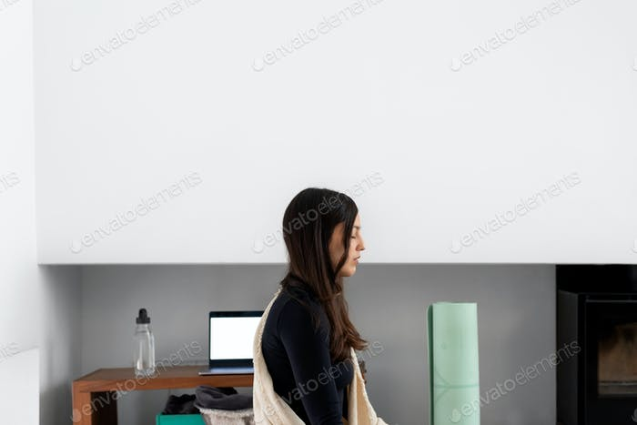 Side view of calm young woman with eyes closed practicing mindfulness
