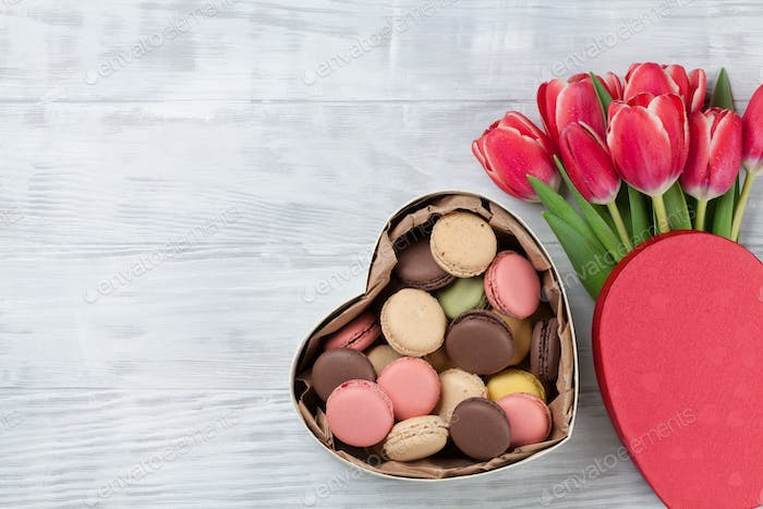 Red tulip flowers and macaroons