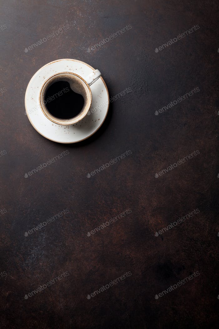 Coffee cup on old kitchen table