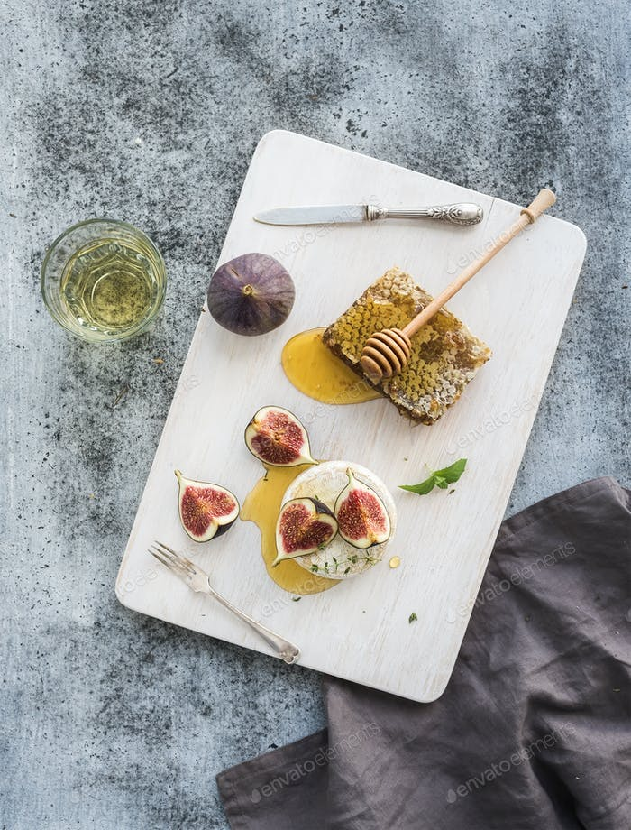 Camembert or brie cheese with fresh figs, honeycomb