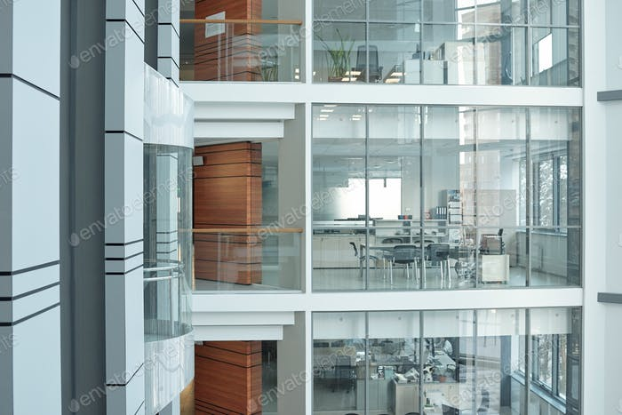 Several floors inside large business center with balconies, windows and offices