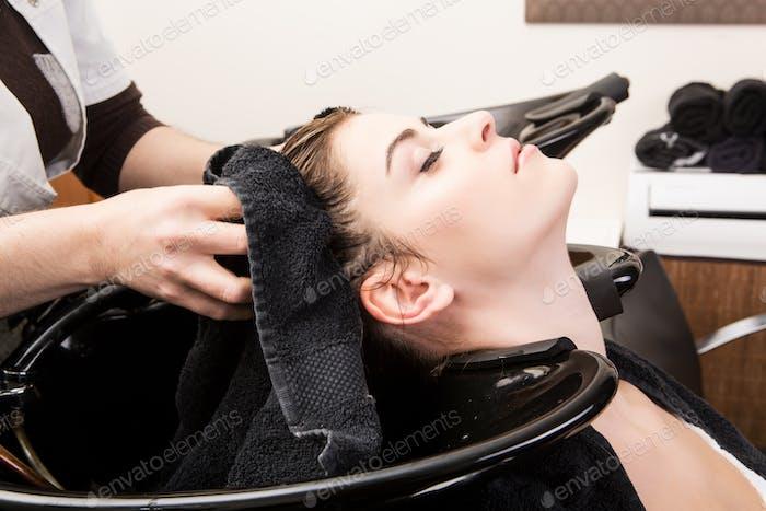 woman washing her hair in hairsalon