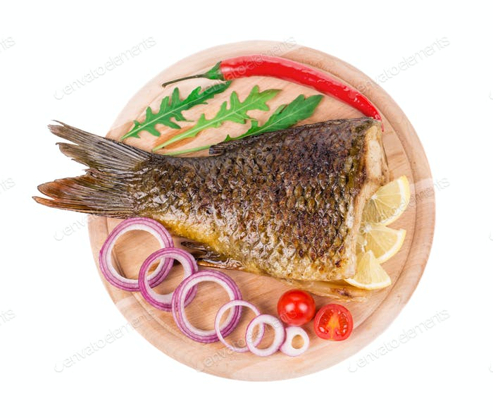 Fried carp tail with lemon and pepper.