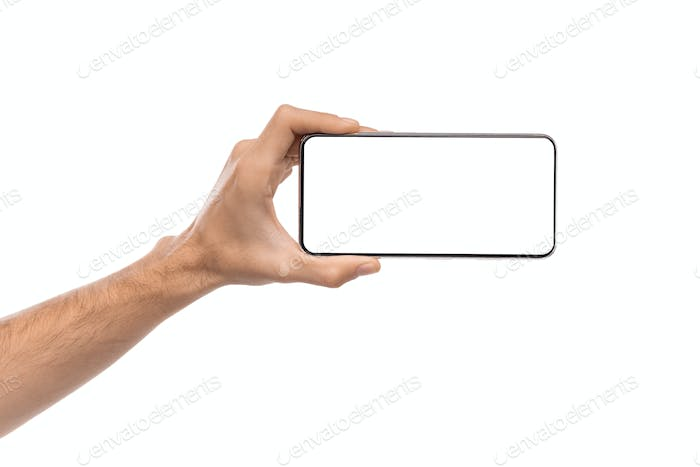 Smartphone with blank screen in horizontal orientation in male hand