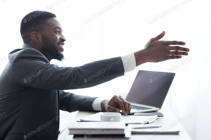Friendly HR manager extending hand for handshake after successful interview