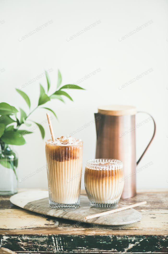 Iced coffee drink in tall glasses on wooden table