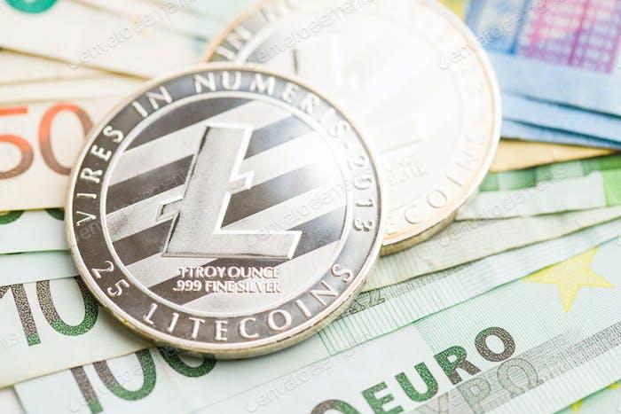 Litecoin and euro banknotes.