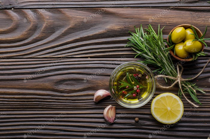 Flat lay Food background frame made of oils condiments and spices on kitchen table